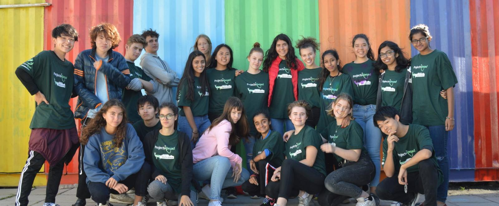 A group of teenagers from the same school on a group volunteer trip to South Africa.